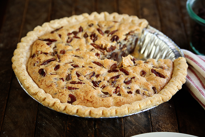 This Kentucky Pecan Pie is a staple dessert on our Thanksgiving table, but is delicious any time of year! This classic easy recipe is cross pecan a pecan pie and a chocolate chip cookie! It's great served warm with a bog ol' scoop of vanilla ice cream!