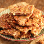 Pieces of Peanut Brittle on serving dish