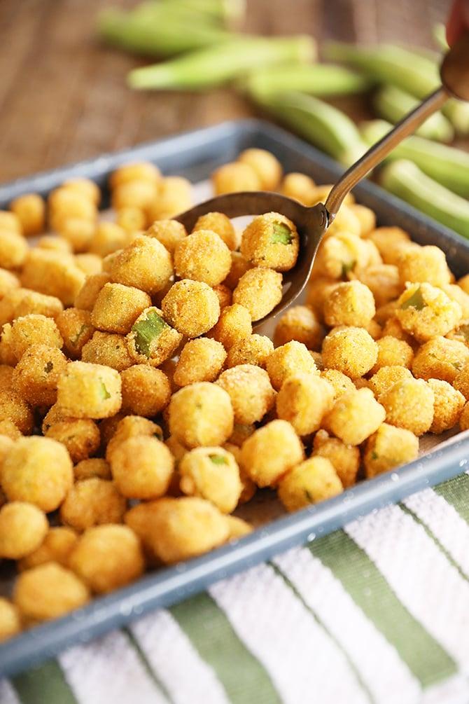 Spooning Fried Okra onto a sheet pan