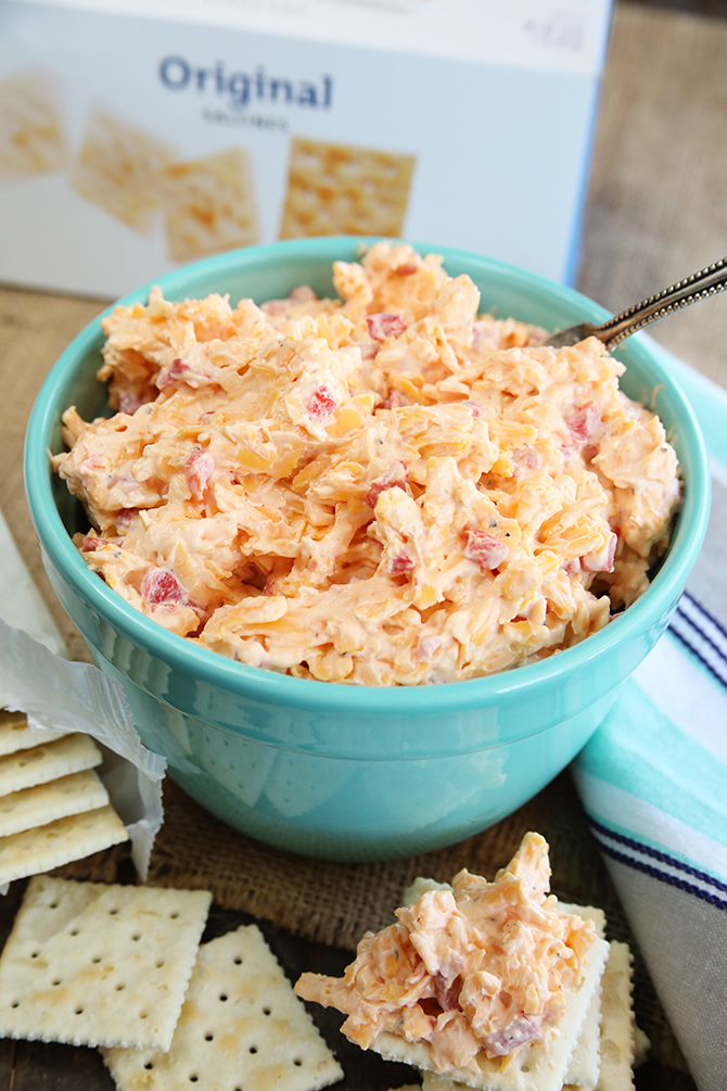 This recipe for classic Southern Pimento Cheese is quick, easy and is filled with amazing flavor. It's perfect on crackers, in sandwiches, veggies, or even melted over burger and hotdogs! I love to make grilled cheeses with pimento cheese!