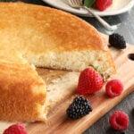 Skillet Cake Slice missing with fruit on side