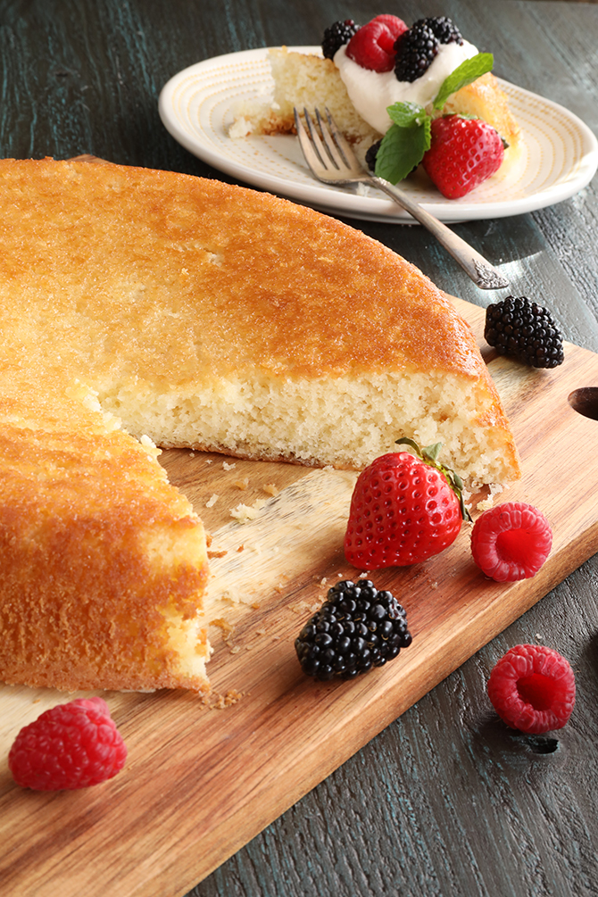This super easy recipe for a rustic Skillet Cake is perfect served with berries and whipped cream and makes a perfect base for strawberry shortcake!
