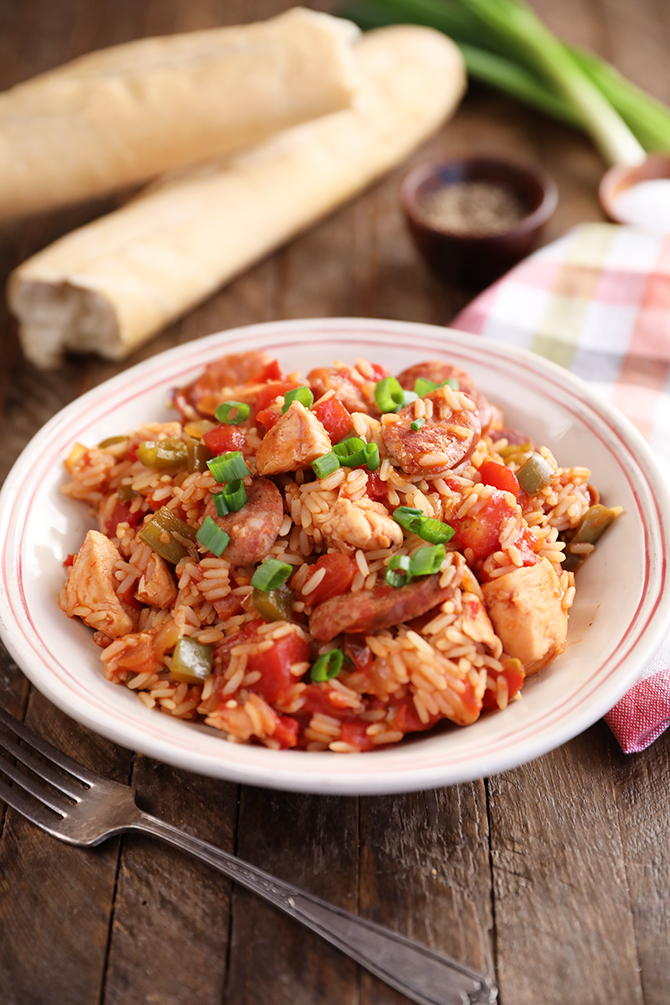 Chicken and Sausage Jambalaya in a bowl with fork and napkins