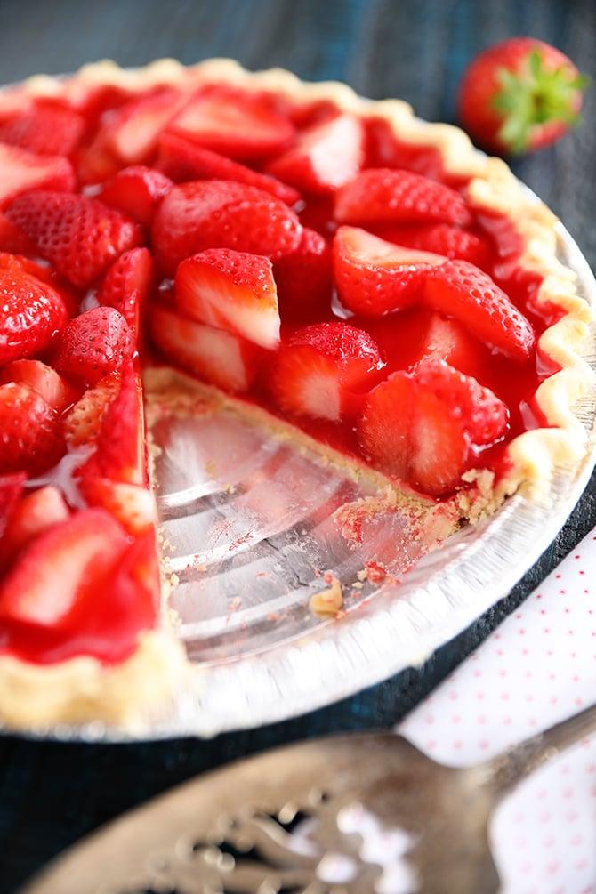 Strawberry pie with piece missing