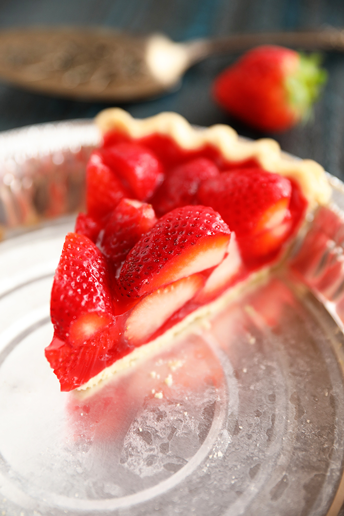Slice of strawberry pie in baking pan
