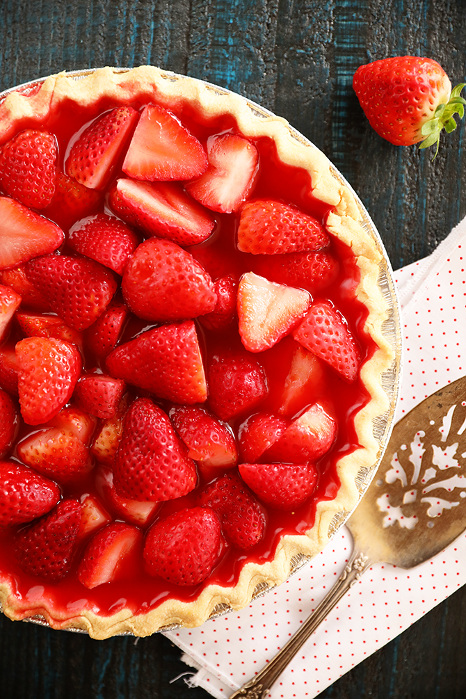 Strawberry pie with serving spoon