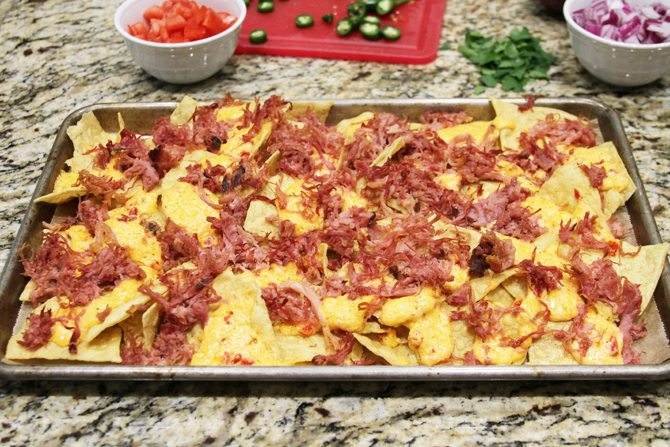 These Southern Sheet Pan Nachos combine smoky pulled pork, melty pimiento cheese, and all your favorite toppings into one amazing pan of food!