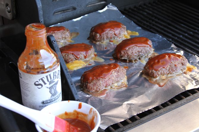 Turn your meatloaf on it's head by making it mini, grilling it, covering it with barbecue sauce, and stuffing it with cheese!