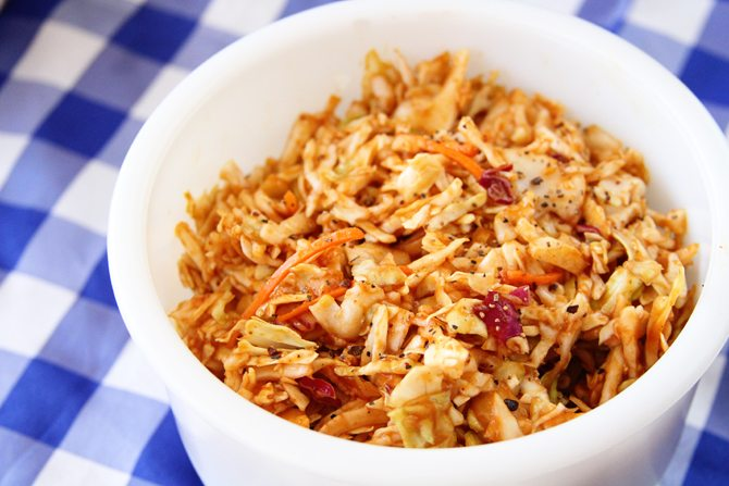 Give your taste buds a kick with this BBQ Cole Slaw - it has tangy bbq sauce as the base for the dressing!
