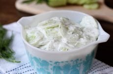The cool and creamy flavors of this Creamy Cucumber Salad make it the perfect summertime side recipe!