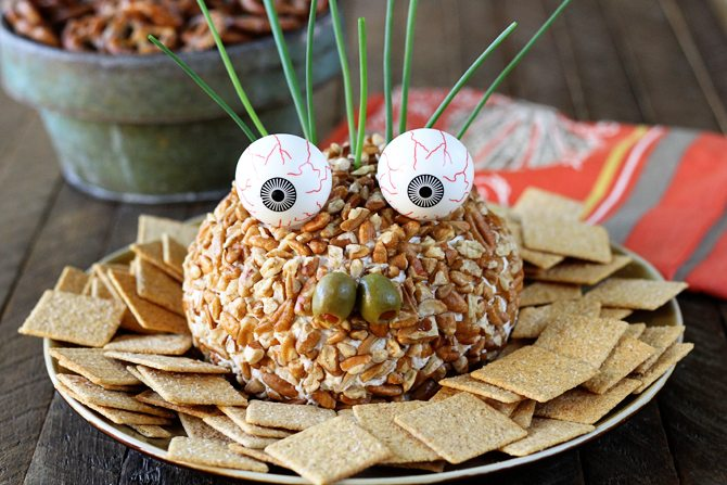 This recipe starts as a delicious Chicken Ranch Cheese Ball and is turned into a ghoulish goblin!