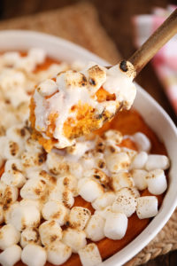 Scoop of Big Mama's Sweet Potato Pudding with melted marshmallows