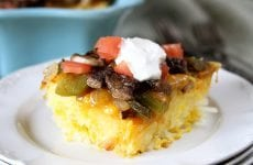 Cheese, eggs, steak, peppers, and onions combine in this Baked Big Steak Omelet!