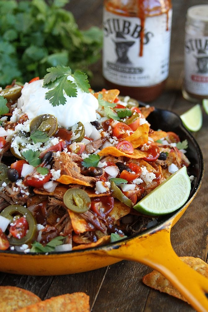 The Slow Cooker does all the hard work with these amazingly delicious LOADED Brisket Nachos!