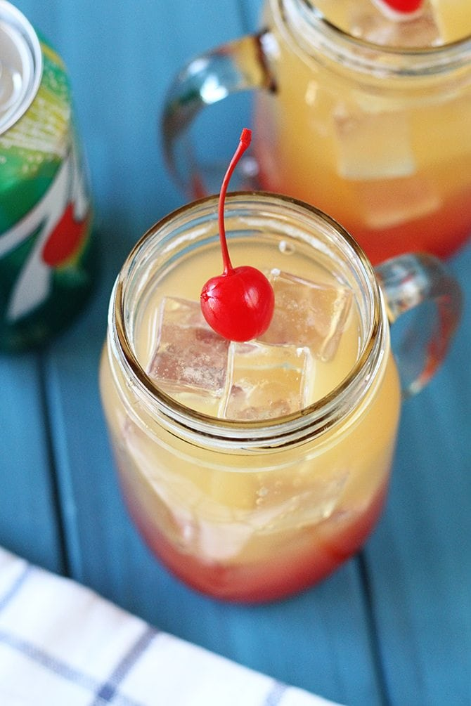 """This kid-friendly Pineapple Sunrise """"cocktail"""" made with 7UP is the perfect thing to keep the kiddos cool this summer! It's pretty cool looking, too! #ad"""