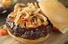Top this sweet and sticky pork burger with homemade peach salsa for an unexpected kick!