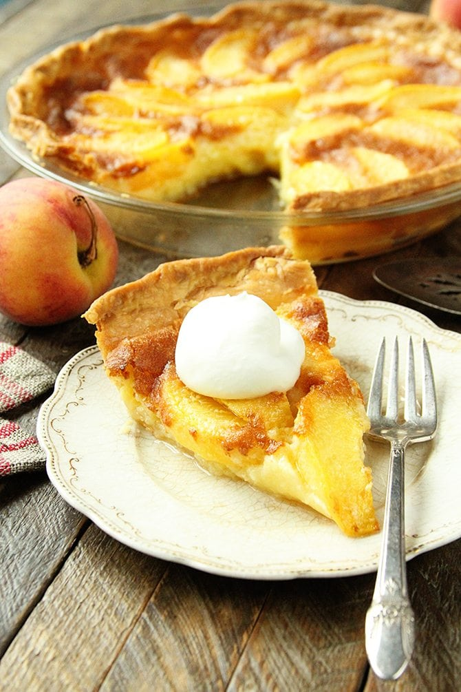 This Peach Chess Pie combines all the flavor of delicious peach cobbler in a decadent custard pie!