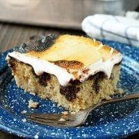 This S'mores Poke Cake recipe turns the campfire favorite into any anytime treat!