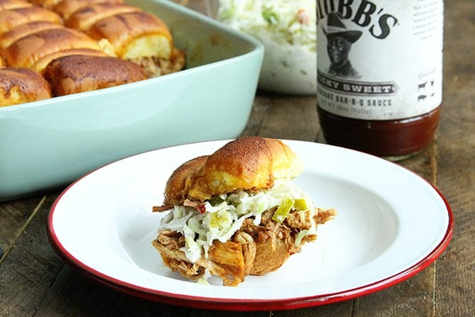 These BBQ Chicken Sliders with Dill Pickle Slaw are perfect for your next tailgate or a casual dinner with friends.  Plus they're made right in the slow cooker!