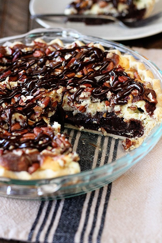 This fudgy top-prize winning Cream Cheese Brownie Pie needs nothing more than an ice-cold glass of milk to make a perfect ending to any meal.