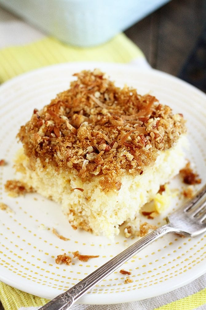 Delightfully different, this pineapple sheet cake recipe is topped with a crunchy mixture of brown sugar, chopped pecans, and coconut!