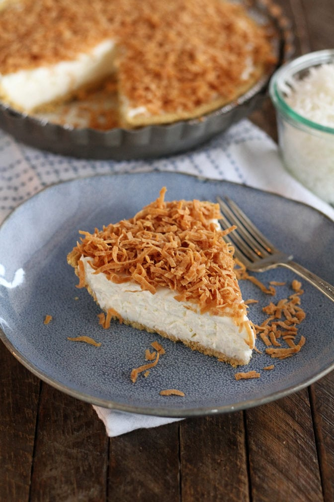 This Creamy Coconut Pie is filled with a creamy coconut and cream cheese filling and is topped with crunchy toasted coconut.