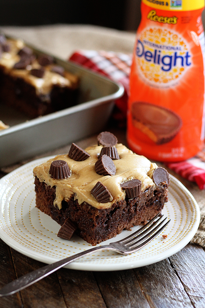 Chocolate Peanut Butter Poke Cake with ingredients in background