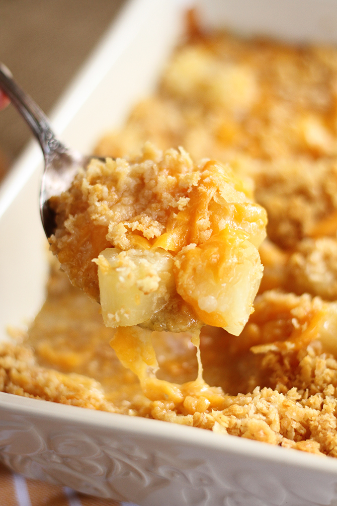 This Pineapple Cheese Casserole is sweet and salty, gooey perfection! The quick and easy recipe combines tangy, sweet pineapple pieces, sharp cheddar cheese, and buttery cracker crumbs!