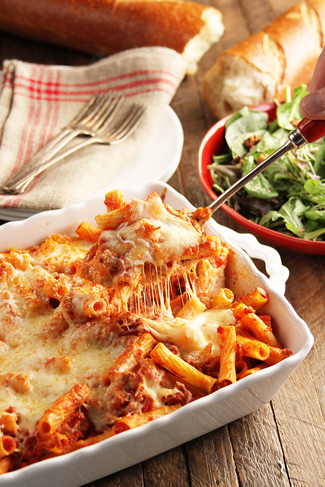 This easy and delicious Cheesy Baked Ziti is perfect for a busy weeknight, but makes enough for company! #sponsored #ziti #recipe #southernbite