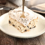 Cookies and Cream Sheet Cake slice with cookies beside plate