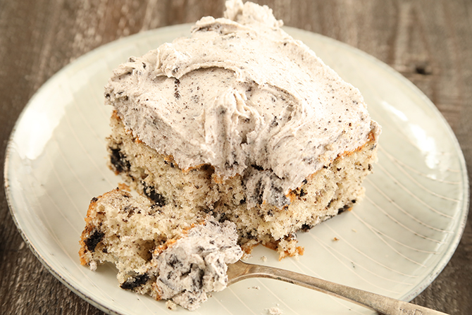 If you're a fan of an Oreo cookie, you're going to love this Cookies and Cream Sheet Cake! And starting with a boxed cake mix makes it SO quick and easy!