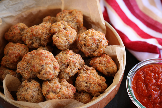 These Pizza Sausage Balls are a fun twist on the classic sausage ball that adds in tons of pizza flavor! Dip them in warm pizza sauce for even more flavor!