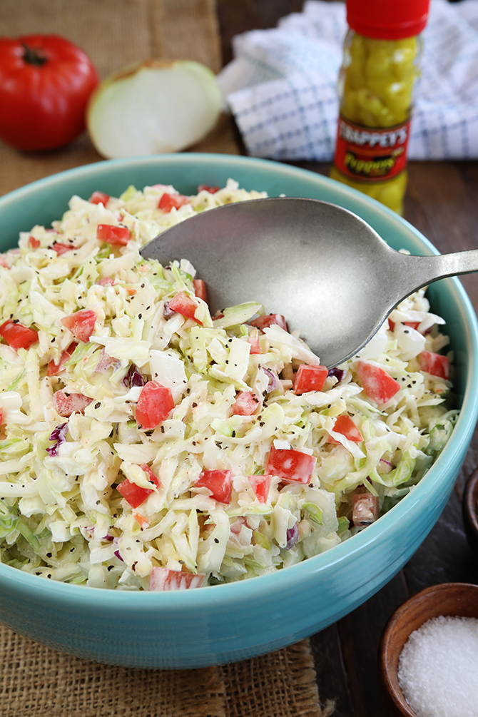 This recipe for Pepper Sauce Coleslaw gets a kick from the vinegar pepper sauce many folks put on Southern greens. It's the perfect summer BBQ side dish!