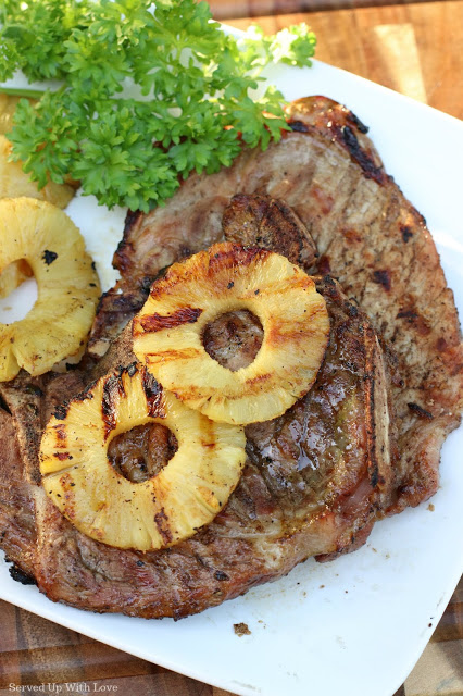 Grilled pork chop with slices of pineapple on top