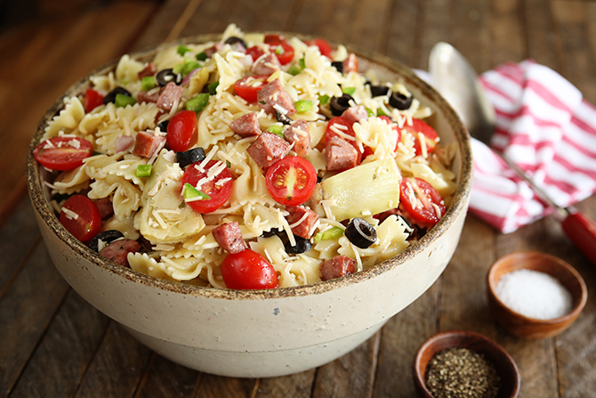 This Kitchen Sink Pasta Salad has all my favorite summer pasta salad ingredients, but the addition of polish sausage really takes it over the top! This recipe is perfect as a side or even a meal all to itself!
