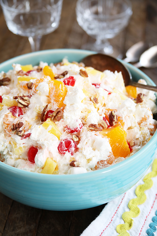 This Southern Ambrosia fruit salad is a quick and easy dessert recipe that's perfect for cooling off this summer!