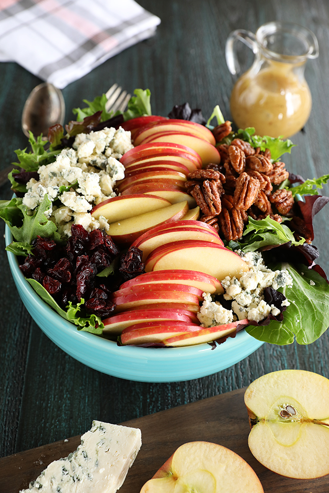 Apple Pecan salad with apples and cheese on side