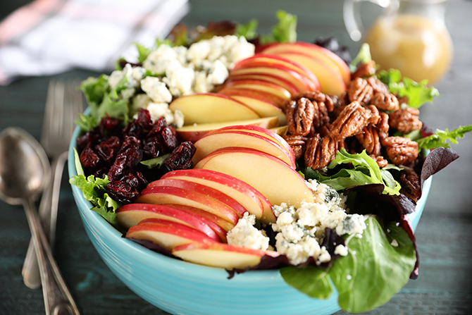 Apple Pecan salad with spoon