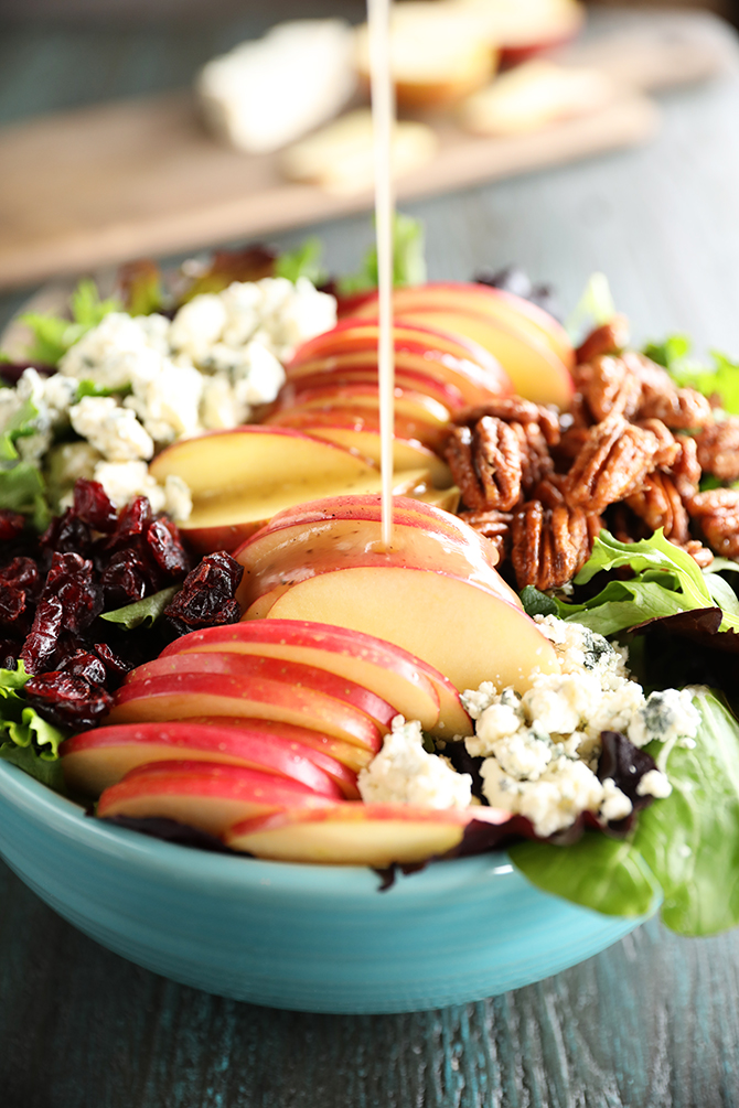 Pouring dressing on Apple salad