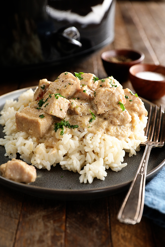 Pork tips over rice with fork