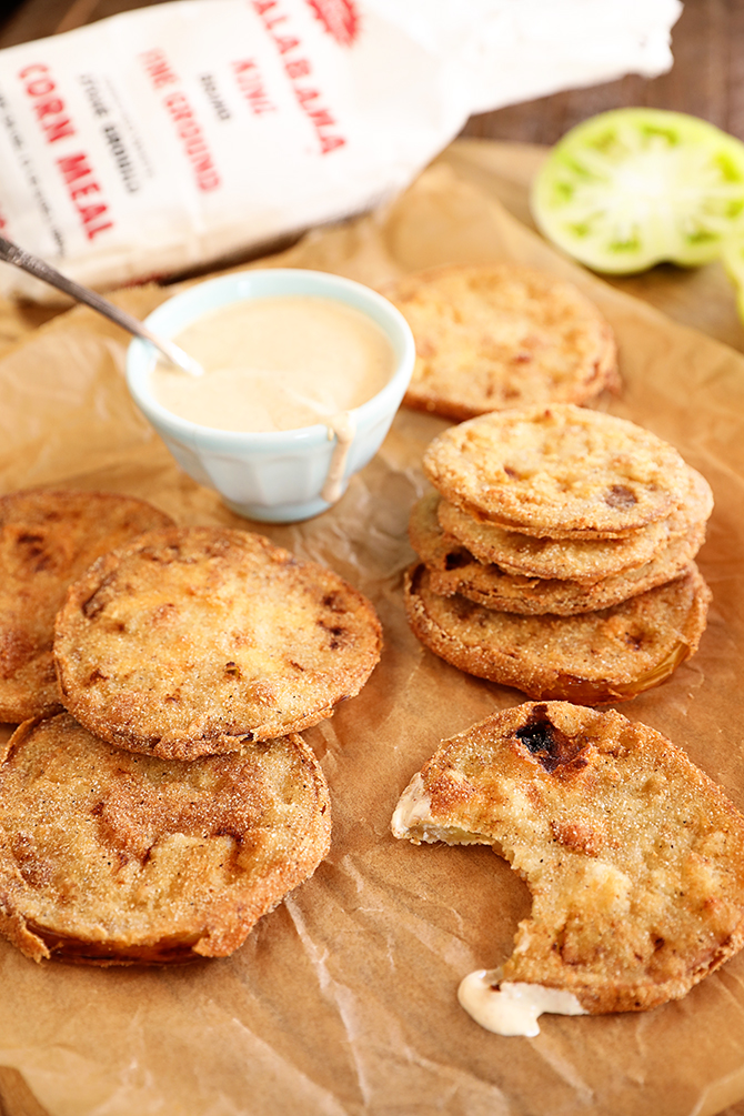 Fried green tomatoes on borwn paper with remoulade sauce