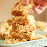 Hand grabbing a Chewy Peanut Butter Cookie Bar from a stack