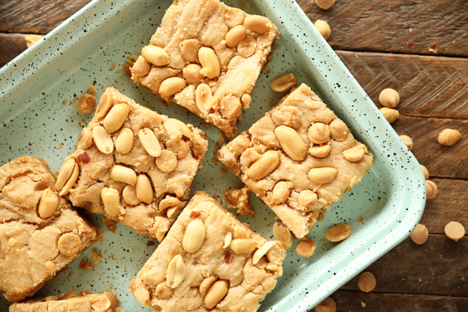 Chewy peanut Butter Cookie Bars on green tray