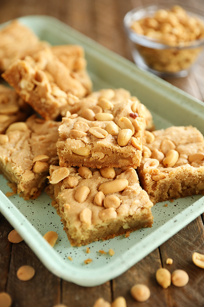 Chewy peanut Butter Cookie bars stacked on green tray