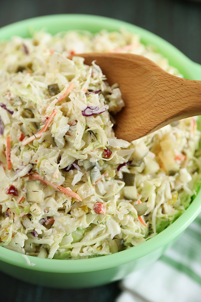 Dill Pickle Coleslaw with wooden spoon
