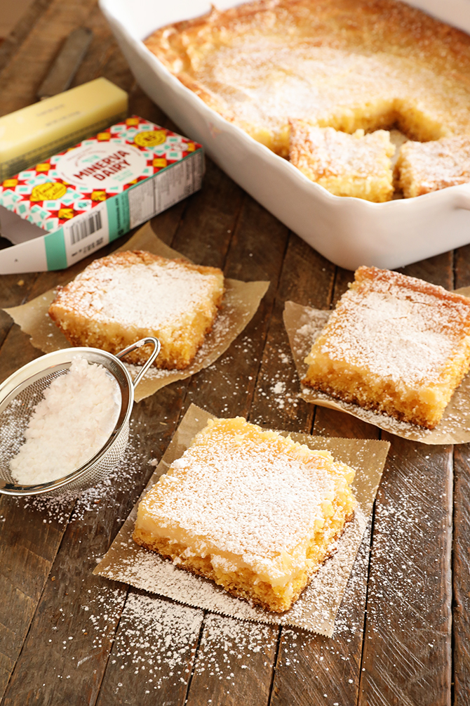 Slices of Gooey butter Cake dusted with powdered sugar