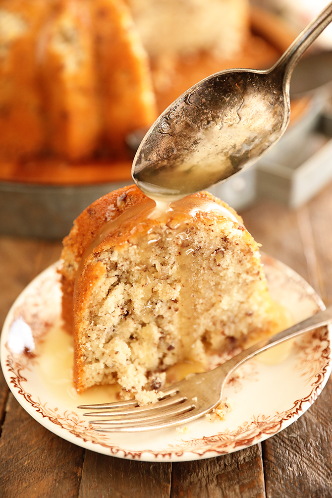 Bama Butter Cake with Butter Sauce Being Spooned over the top