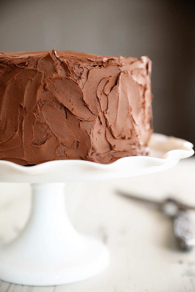 Triple Chocolate Mousse Cake on cake stand