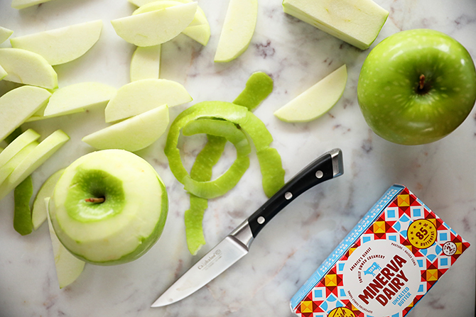 Peeled apples with knife