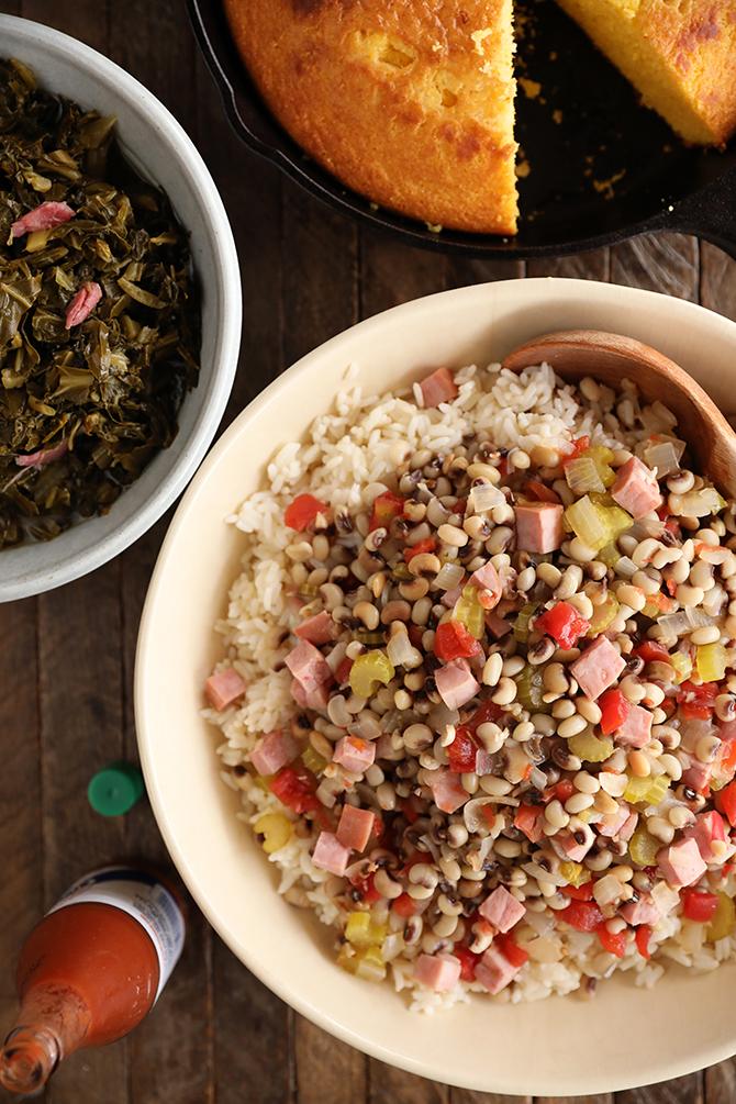 Bowl of Hoppin' John, bowl of collard, pan of cornbread